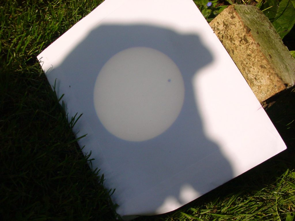 Transit of Venus photographed projected on paper through binoculars.