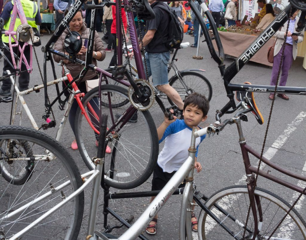 Child cranking bicycle sculpture at the Oxford Big Green Day Out